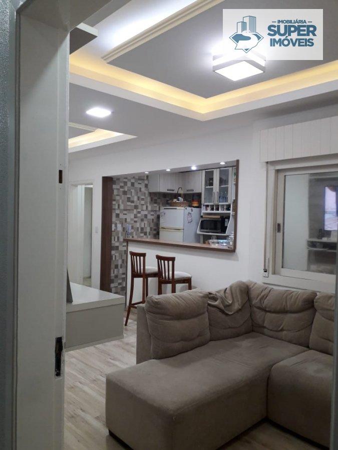 Apartamento a Venda no bairro Centro em Pelotas - RS. 2 banheiros, 2 dormitórios, 1 vaga na garagem, 1 cozinha,  área de serviço,  lavabo,  sala de es